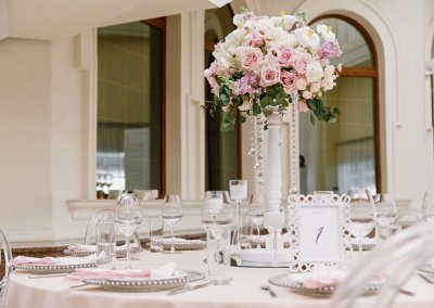 Fashionable artistic design of wedding table for classic wedding by flowers and white elements