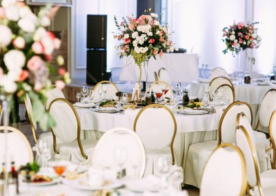 Many tables with flowers for the wedding guests